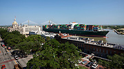 The Evergreen vessel Triton sails past Savannah's Historic River Street and City Hall after visiting the Georgia Ports Authority's Port of Savannah, Wednesday, May, 22, 2019, in Savannah, Ga. The Triton is the first 14K TEU Evergreen vessel to call the East Coast and  (GPA Photo/Stephen B. Morton)