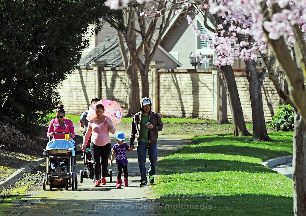 A family enjoys Saturday's warm weather on the trails along Hancock Street in Salinas' Creekbridge neighborhood.