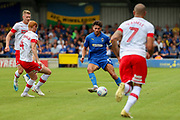 AFC Wimbledon defender Will Nightingale (5) passing the ball during the EFL Sky Bet League 1 match between AFC Wimbledon and Rotherham United at the Cherry Red Records Stadium, Kingston, England on 3 August 2019.