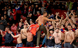Shirtless CSKA Moscow fans in the stands show their support during the match