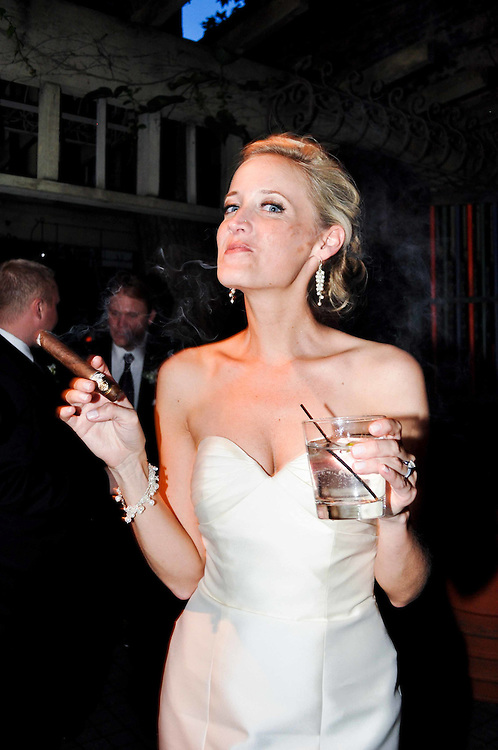 Kelly enjoys a cigar during her wedding reception at A New Leaf, Chicago, IL
