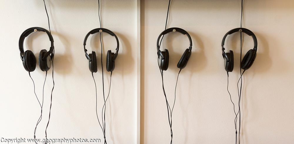 Hauser and Wirth art gallery, restaurant and garden, Durslade Farm, Bruton, Somerset, England, UK headphones against wall