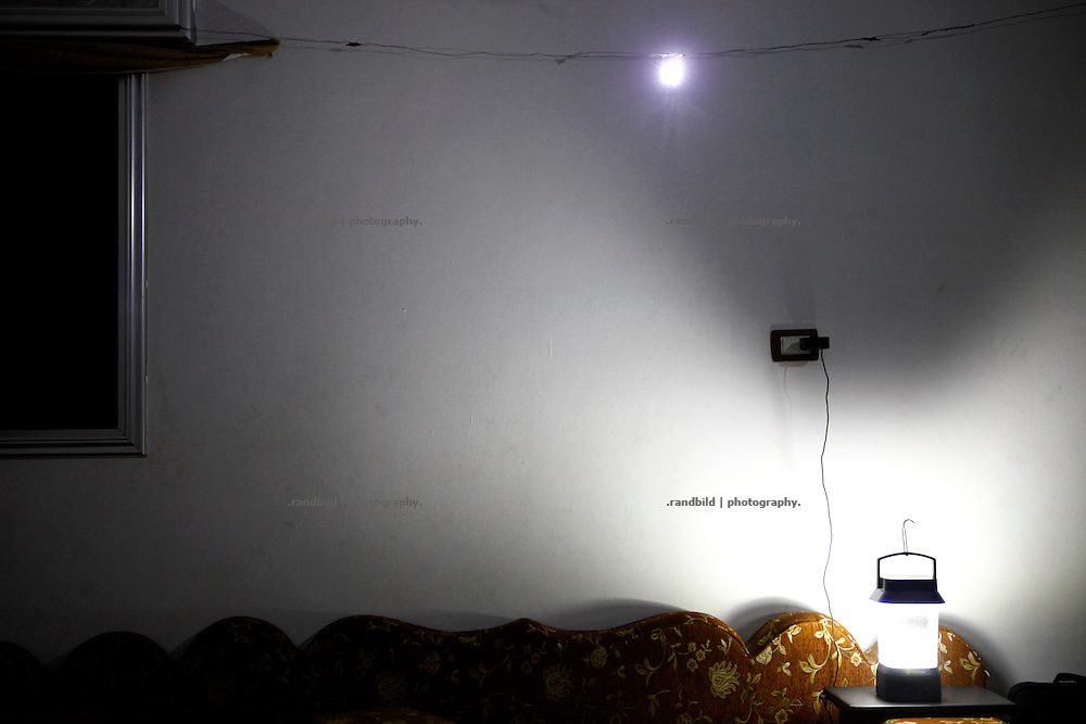 Battery and solar charged LED panels became a regular lightning system in Koreen as regular blackouts must be bridged.<br /> _ _ _ <br /> Idlib Interim - Challenging life without central government in the village of Koreen (Idlib Province, Syria)<br /> Koreen joint the syrian uprisung to ouster president Bashar al-Assad at a very early stage in 2011. It has been scene of Army attacks and heavy shelling since 2012. In the course of the fightings the village of a few thousend inhabitants was almost abandoned as barrel bomb campaings commited by the regime pounded Koreen. But since regime forces retreated to few bases remaining in Idlib province people returned home to establish a new and almost unregulated economic, social and community life. The regimes power has no affect and can&acute;t reach them anymore. On the other hand a new government isn&acute;t established yet and not in sight at all. Koreen is free to make its way.