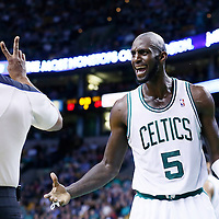 21 December 2012: Boston Celtics power forward Kevin Garnett (5) argues with referee Sean Wright (65) during the Milwaukee Bucks 99-94 overtime victory over the Boston Celtics at the TD Garden, Boston, Massachusetts, USA.