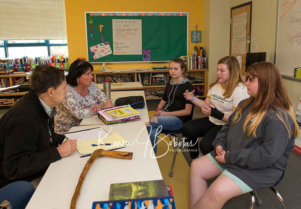 "Mayor Ed Engler and Whitney McCallum listen as Madelyn Young, Cali Andriski and Riley Clark-Patten bring ideas towards solving city problems posed by Mayor Engler during McCallum's ""genius hour"" at Laconia Middle School on Wednesday afternoon.    (Karen Bobotas/for the Laconia Daily Sun)"