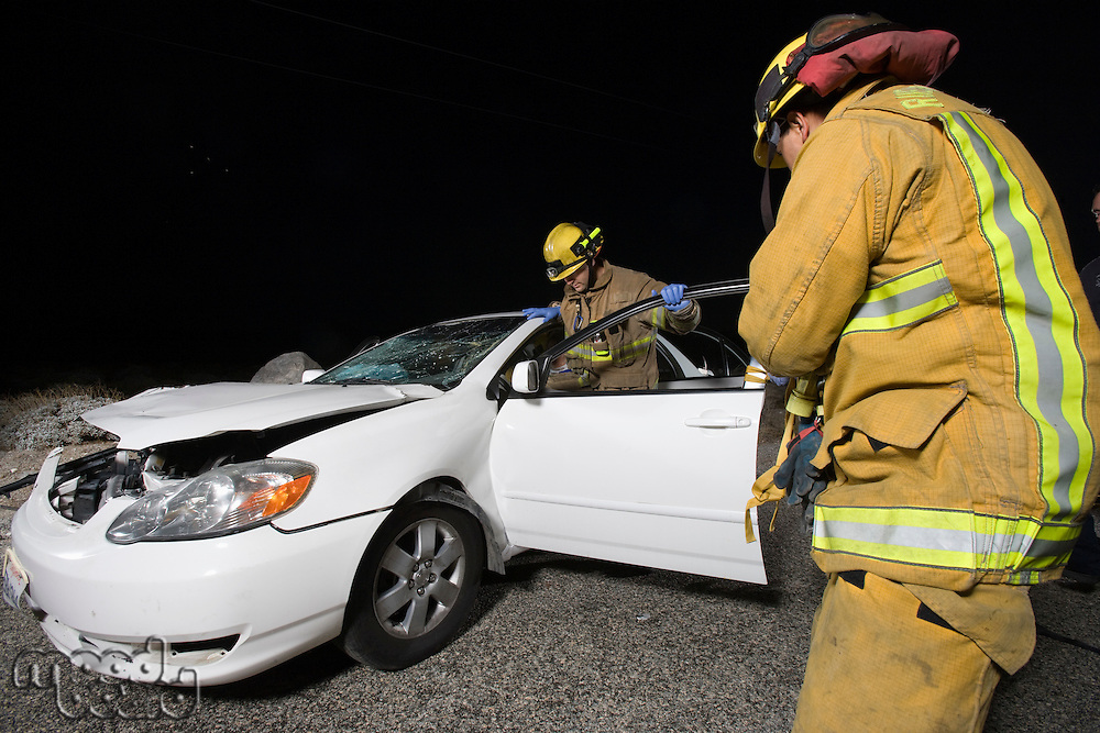 Firefighters rescuing car accident victim