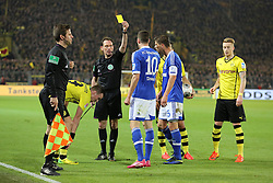 25.03.2014, Signal Iduna Park, Dortmund, GER, 1. FBL, Borussia Dortmund vs Schalke 04, 27. Runde, im Bild Julian Draxler (FC Schalke 04 #10) bekommt die gelbe Karte von / yellow card Schiedsrichter Florian Meyer (Burgdorf) nach einem Foul an Kevin Grosskreutz (Borussia Dortmund #19 - links) // during the German Bundesliga 27th round match between Borussia Dortmund and Schalke 04 at the Signal Iduna Park in Dortmund, Germany on 2014/03/25. EXPA Pictures &copy; 2014, PhotoCredit: EXPA/ Eibner-Pressefoto/ Schueler<br /> <br /> *****ATTENTION - OUT of GER*****