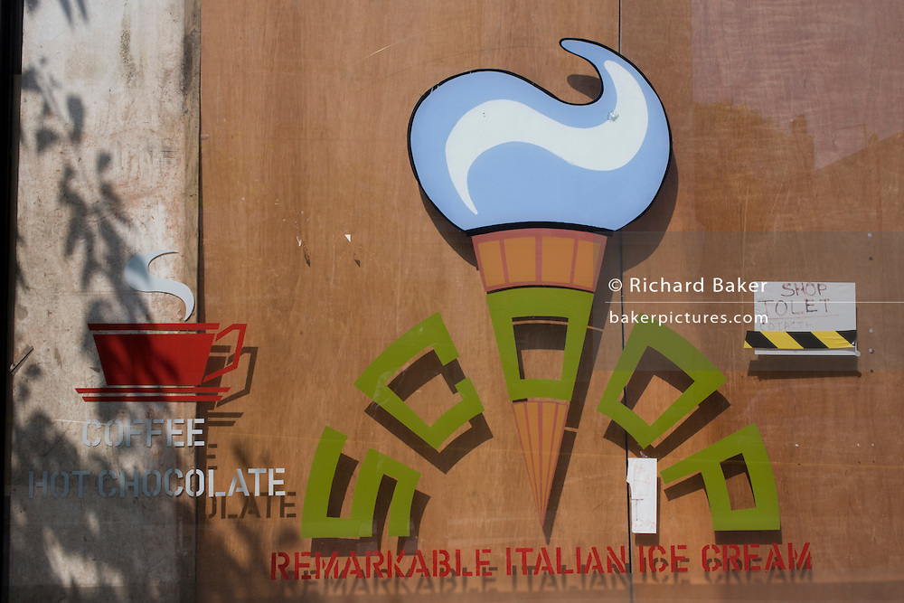 The window of a closed local Italian ice cream business in south London.