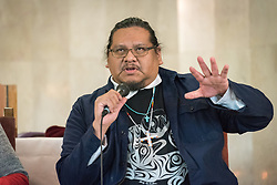 8 December 2019, Madrid, Spain: Rev. Tony Snow, an indigenous person from the United Church of Canada speaks during a session following an ecumenical prayer service held in the Iglesia de Jesús in central Madrid during COP25.