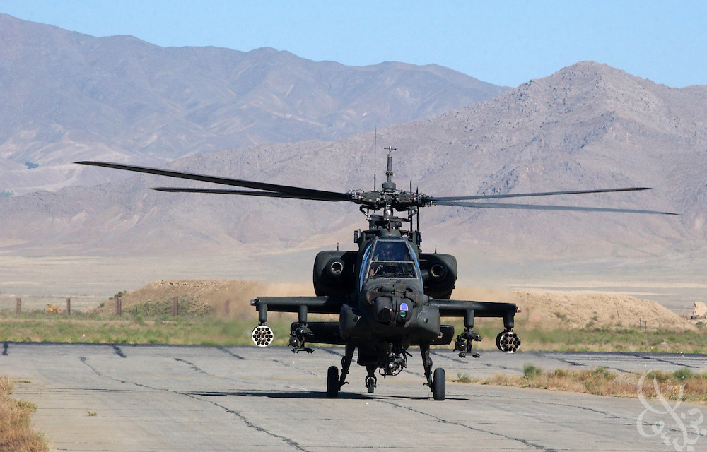 A U.S. Army AH-64 Apache helicopter gunship returns from a mission across the Baba mountain range June 17, 2002 at the Bagram Air Base in Afghanistan. Coalition forces continue to scour Afghanistan for traces of remaining al Qaeda and Taliban fighters as part of the ongoing Operation Enduring Freedom.