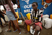 Rafael Yeboah, 13, waits to fill his plastic containers with water from a tap in a poor neighborhood of Accra, Ghana's capital, on Monday Mar 5, 2007. Only when Rafael will have finished transporting the water home will he be able to head to school. Most parts of the city are plagued with intermittent water shortages, and people buy water from the few running taps. They then have to carry the containers to their homes over distances that often reach several hundred meters. Meanwhile, Ghana is preparing to celebrate its 50 years of independence from the UK on March 6th.