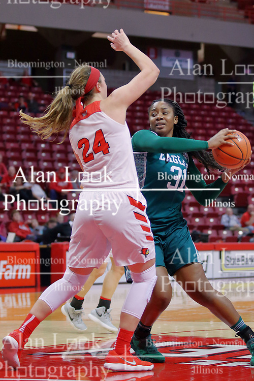 10 December 2017: Lorraine Enabulele defended by Megan Talbot during an College Women's Basketball game between Illinois State University Redbirds and the Eagles of Eastern Michigan at Redbird Arena in Normal Illinois.