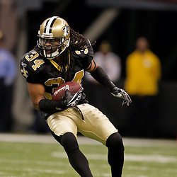 2009 November 30: New Orleans Saints cornerback Mike McKenzie (34) runs back an interception during a 38-17 win by the New Orleans Saints over the New England Patriots at the Louisiana Superdome in New Orleans, Louisiana.