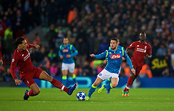 LIVERPOOL, ENGLAND - Tuesday, December 11, 2018: Liverpool's Virgil van Dijk tackles Napoli's Dries Mertens, and receives a yellow card, during the UEFA Champions League Group C match between Liverpool FC and SSC Napoli at Anfield. (Pic by David Rawcliffe/Propaganda)