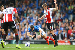 William Boyle of Cheltenham Town trips Conor Chaplin of Portsmouth - Mandatory by-line: Jason Brown/JMP - 06/05/2017 - FOOTBALL - Fratton Park - Portsmouth, England - Portsmouth v Cheltenham Town - Sky Bet League Two