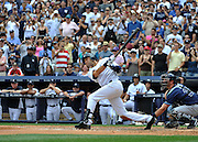New York Yankees' Derek Jeter hits a solo home run for his 3000th career hit in the third inning of a baseball game on Saturday, July 9, 2011 at Yankee Stadium in New York. (AP Photo/Kathy Kmonicek)