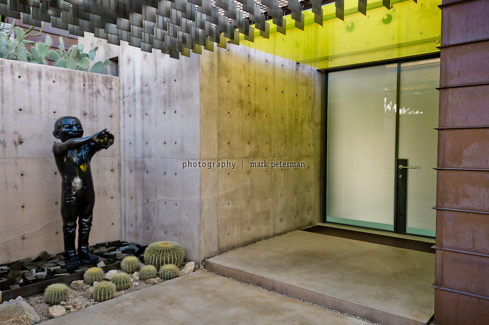 Scottsdale, AZ-Kent and VIcki Logan residence-03/03/11 Front entryway with Contemporary Terracotta Warrior by Yue Minjin. Mark Peterman for The Wall Street Journal