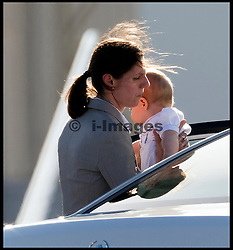 George's nanny Maria Teresa Turrion Borrallo carries Prince George into the car as The Duke and Duchess of Cambridge arrive at Sydney airport, Australia, with Prince George on day 10 of their Royal Tour of New Zealand and Australia, Wednesday, 16th April 2014. Picture by  i-Images