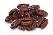 sugared Pecan Nuts (Carya illinoensis) On white Background
