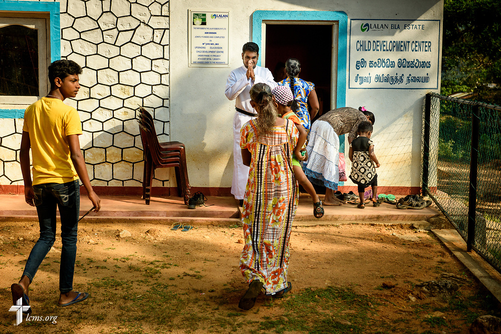 The Rev. P. Gnanakumar greets church members before worship at the Eila rubber plantation in the Sabaragamuwa Province of Sri Lanka on Sunday, Jan. 21, 2018. When this photograph was made, church members were using a school building as a worship space. LCMS Communications/ Erik M. Lunsford