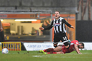 Grimsby Town player Billy Clarke (16) and Morecambe FC player Aaron Wildig (15) during the EFL Sky Bet League 2 match between Grimsby Town FC and Morecambe at Blundell Park, Grimsby, United Kingdom on 15 February 2020.