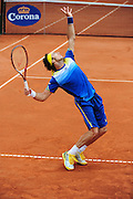 Juan Monaco in a trophy position while serving during the semifinal at the Power Horse Cup 2013 at Rochusclub in Duesseldorf, Germany on May 24, 2013. Photo: Miroslav Dakov