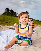Lucas enjoying the corner spot of the blanket while at Sombrero Beach.