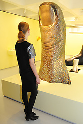 © Licensed to London News Pictures. 21/10/2013. London, UK. A woman views Le Grand Pouce (Large Thumb) by Cesar Baldaccini at The Pop Art Design Exhibition preview at The Barbican Centre. Photo credit : David Mirzoeff/LNP