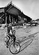 Keith Powell, 13, tours the destruction of his neighborhood along 54th street and 27th Avenue in Liberty City during the 1980 McDuffie riots in Miami.