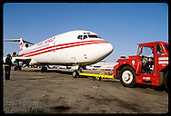 Ramp crew pushes TWA 727 back from concourse while talking to pilot; Lambert Airport/St. Louis Missouri