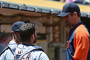 May 29, 2014; Oakland, CA, USA; Detroit Tigers manager Brad Ausmus (7, right) talks to catcher Alex Avila (13, left) during the second inning against the Oakland Athletics at O.co Coliseum. The Tigers defeated the Athletics 5-4.