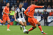 West Bromwich Albion forward Jay Rodriguez (19) takes on Millwall defender Jake Cooper (5) during the EFL Sky Bet Championship match between West Bromwich Albion and Millwall at The Hawthorns, West Bromwich, England on 22 September 2018.