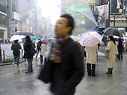 people on there way to work on a rainy day Ginza Tokyo