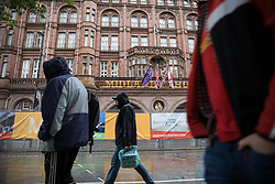 © Licensed to London News Pictures . 30/09/2017. Manchester, UK. People outside the secured Midland Hotel as Manchester prepares for the Conservative Party Conference , which is taking place inside a secured zone around the Manchester Central Convention Centre . Photo credit: Joel Goodman/LNP