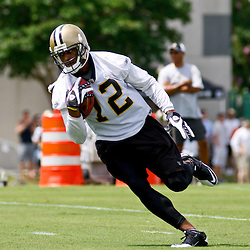 June 5, 2010; Metairie, LA, USA; New Orleans Saints wide receiver Marques Colston (12) runs after a catch during a mini camp practice at the New Orleans Saints practice facility. Mandatory Credit: Derick E. Hingle