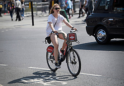 © Licensed to London News Pictures. 22/04/2019. London, UK. A young woman rides a bike through Westminster in London, on what has been a record breaking Easter bank holiday weekend for temperatures. Photo credit: Ben Cawthra/LNP
