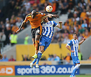 Wolverhampton Wanderers striker Benik Afobe beats Brighton central defender, Lewis Dunk in the air during the Sky Bet Championship match between Wolverhampton Wanderers and Brighton and Hove Albion at Molineux, Wolverhampton, England on 19 September 2015.