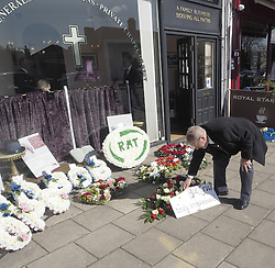 An RMT Union member lays a plaque in honour of RMT Union Leader Bob Crowe  in the Woodford Green high street, London shortly before Bob Crowe's funeral, London, United Kingdom, United Kingdom. Monday, 24th March 2014. Picture by Max Nash / i-Images