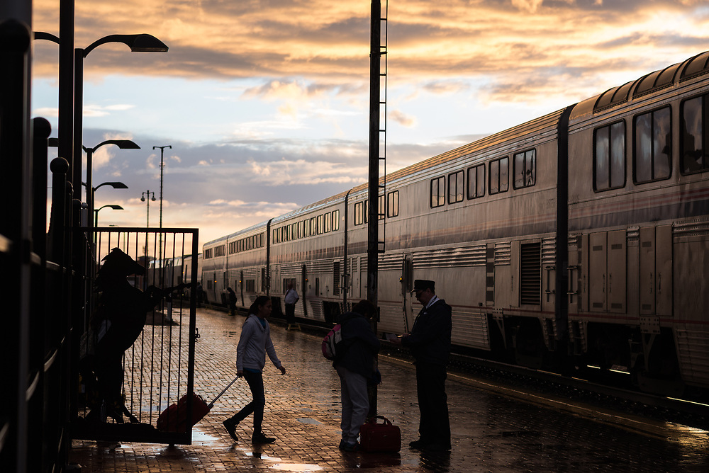 Passengers board the Westbound Amtrak train in Gallup, New Mexico as the sun sets.