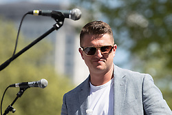 "© Licensed to London News Pictures . 06/05/2018. London, UK. TOMMY ROBINSON . Supporters of alt-right and anti-Islam groups, including Generation Identity and the Democratic Football Lads Alliance, demonstrate at Whitehall in Westminster, opposed by anti-fascists. Speakers billed in the ""Day for Freedom"" include former EDL leader Tommy Robinson, Milo Yiannopoulos, youtuber Count Dankula (Markus Meechan), For Britain leader Anne Marie Waters, UKIP leader Gerard Batten, Breitbart's Raheem Kassam and Lauren Southern. The event was originally planned as a march to Twitter's HQ in protest at their banning of Robinson and the Home Office's ban on Martin Sellner and Brittany Pettibone entering the UK, in what protesters describe as limits being imposed on free speech. Photo credit: Joel Goodman/LNP"