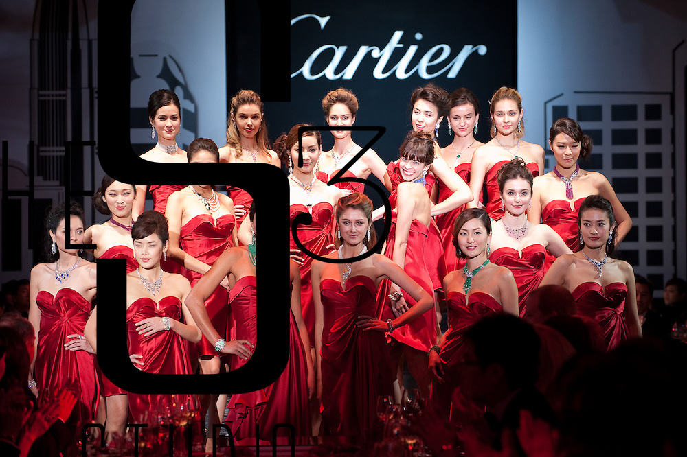 Models showcase Cartier jewelry during the Cartier Flagship Opening Gala Dinner on November 26, 2010 in Hong Kong. Photo by Victor Fraile / Getty Images for Cartier