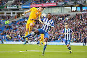 Preston North End midfielder Alan Browne (16) battles in the air with Brighton & Hove Albion defender Gaetan Bong (12) during the Sky Bet Championship match between Brighton and Hove Albion and Preston North End at the American Express Community Stadium, Brighton and Hove, England on 24 October 2015. Photo by Phil Duncan.