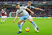 West Ham United midfielder Robert Snodgrass (11) holds off Burnley defender Charlie Taylor (3)  during the Premier League match between Burnley and West Ham United at Turf Moor, Burnley, England on 30 December 2018.