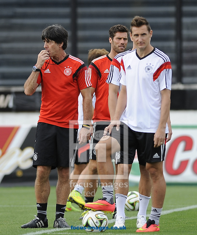 Germany manager Joachim Low and his players during Germany training at Maracana Stadium, Rio de Janeiro<br /> Picture by Stefano Gnech/Focus Images Ltd +39 333 1641678<br /> 12/07/2014