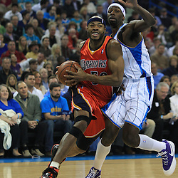 30 January 2009: Golden State Warriors forward Corey Maggette (50) drives past New Orleans Hornets forward Julian Wright (32) during a 91-87 loss by the New Orleans Hornets to Golden State Warriors at the New Orleans Arena in New Orleans, LA.