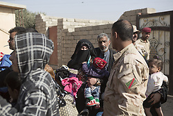November 11, 2016 - Mosul, Nineveh, Iraq - 11/11/2016. Mosul, Iraq. Iraqi refugees, who have fled fighting within Mosul, board Iraqi Army trucks as they prepare to leave the city's Hay Intasar district for the safety of a refugee camp. Hay Intisar district was taken four days ago by Iraqi Security Forces (ISF) and, despite its proximity to ongoing fighting between ISF and ISIS militants, many residents still live in the settlement without regular power and water and with dwindling food supplies...The battle to retake Mosul, which fell June 2014, started on the 16th of October 2016 with Iraqi Security Forces eventually reaching the city on the 1st of November. Since then elements of the Iraq Army and Police have succeeded in pushing into the city and retaking several neighbourhoods allowing civilians living there to be evacuated - though many more remain trapped within Mosul. (Credit Image: © Matt Cetti-Roberts via ZUMA Wire)