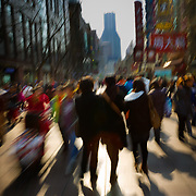 Pedestrians move along the street scape of Shanghai China.
