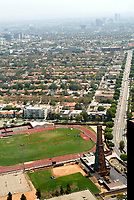 Jul 21, 2003; Beverly Hills, California, USA; Beverly Hills, home to some of America's most exclusive neighborhoods, collects hundreds of thousands of dollars per year in royalties from the oil wells disguised on the high school campus that have been drilling since 1906. Enviornmental activists ED MASRY and ERIN BROCKOVICH are fighting a nasty legal battle defending Beverly Hills High School Alumni who believe they contracted cancer from toxic chemicals released during oil driling. Overall view of school, baseball & football fields, tennis courts, track and surrounding areas looking east from Century City towers. .  <br />