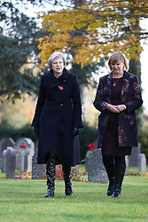 Prime Minister Theresa May (left) walks at the St Symphorien Military Cemetery in Mons, Belgium, with Liz Sweet, Director, External Relations, Western Europe Area, Commonwealth War Graves Commission.