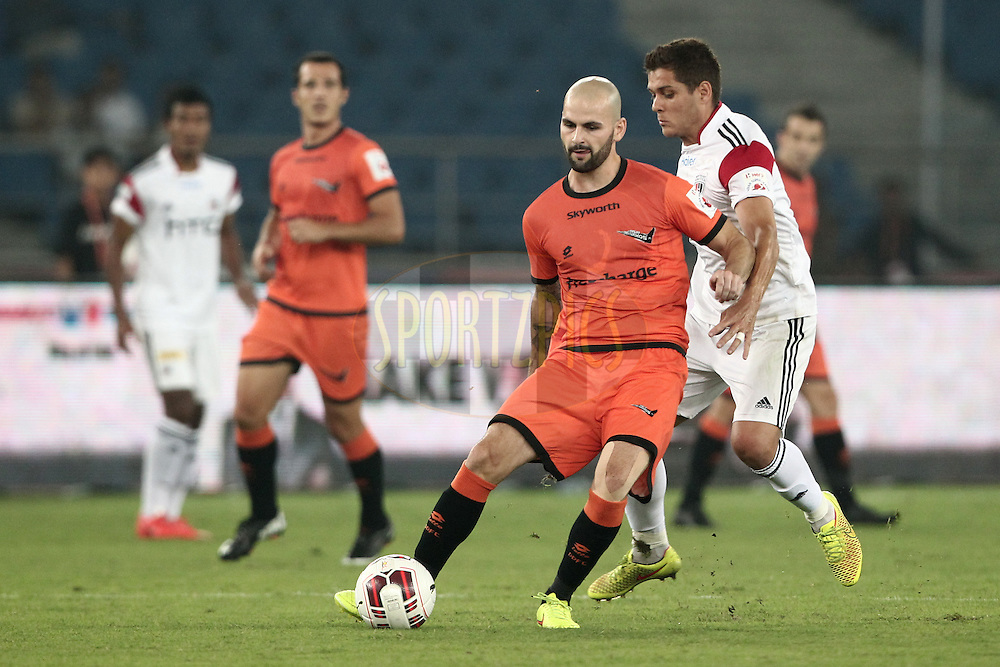 Hans Mulder of Delhi Dynamos FC run against the Guilherme Felipe de Castro of NorthEast United FC during match 16 of the Hero Indian Super League between The Delhi Dynamos FC and NorthEast United FC held at the Jawaharlal Nehru Stadium, Delhi, India on the 29th October 2014.<br /> <br /> Photo by:  Deepak Malik/ ISL/ SPORTZPICS